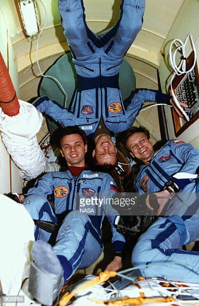 Three Mir-20 crew members are seen in the docking module which was delivered to Russia's Mir Space Station by the Space Shuttle Atlantis in March of...