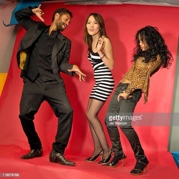 three models dancing after a photo session - mongolian models stock pictures, royalty-free photos & images