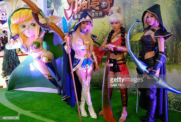 Three models dressed in game costumes for the cosplay pose during the 2015 Taipei Game Show at the World Trade Center on January 28 2015 Over 1400...
