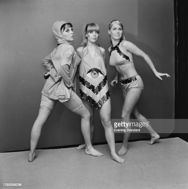 Three models in unusual swimsuits, one featuring a giant eye, UK, September 1967.