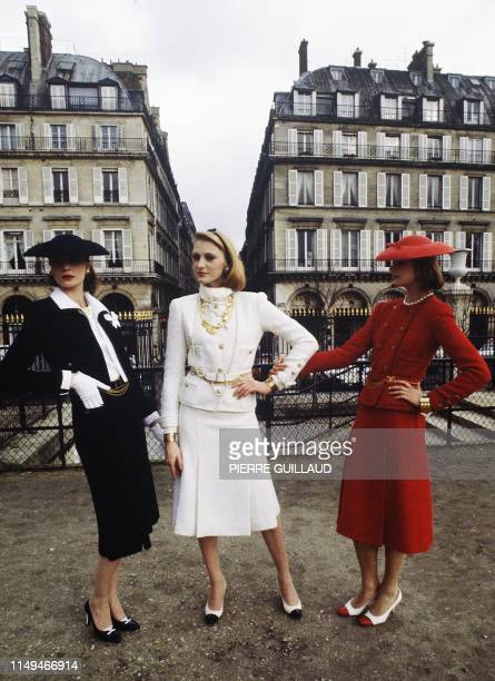 Three models present three blue white and red suits in wool for the high fashion springSummer collection for the Chanel 18 January 1983 in Paris