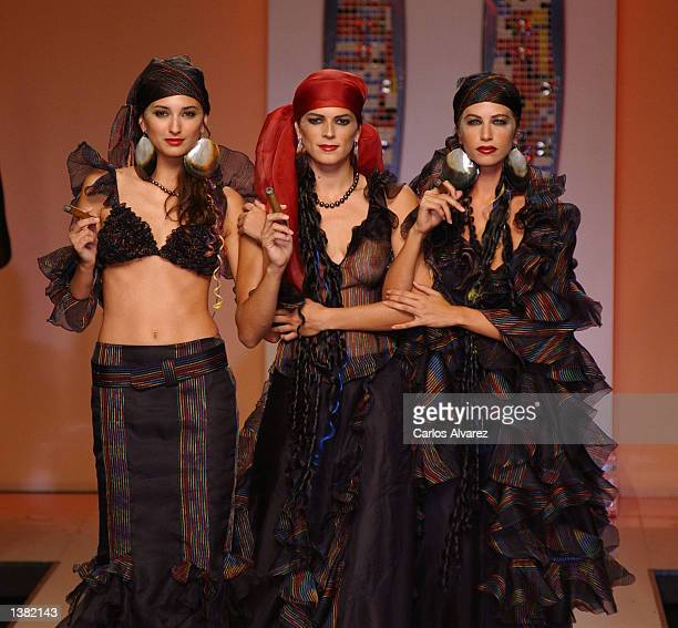 Three models wear outfits from the Montesinos Alama Spring/Summer 2003 collection September 13 2002 on the last day of the Cibeles Fashion Week in...