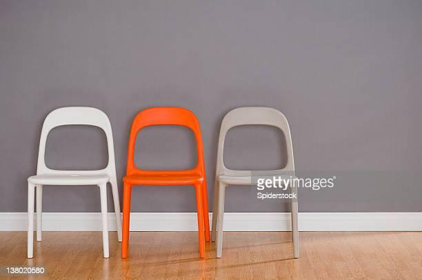 Three Modern Plastic Chairs
