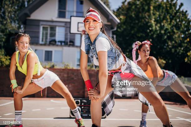 three modern young female dancers dancing outdoors on a sunny summer day - hip hop music stock pictures, royalty-free photos & images