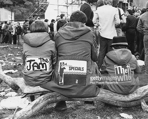 Three mods at the Loch Lomond Rock Festival Scotland circa 1980 The backs of their parkas are decorated with patches for The Jam The Specials and The...