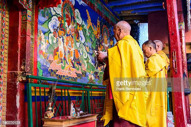 LADAKH LAMAYURU JAMMU KASHMIR INDIA Three monks of Lamayuru Gompa the oldest and largest existing monastery in Ladakh and built on a hill at an...