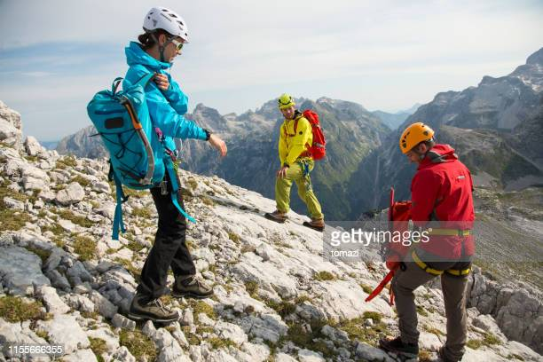 three mountaineers just reached the top - climbing equipment stock pictures, royalty-free photos & images