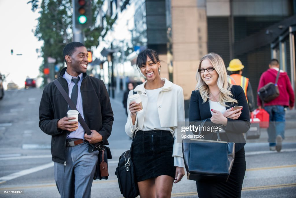 Three Multi Ethnic Millennials in business attire with coffee in Downtown Los Angeles : Stock Photo