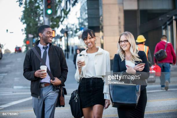 Three Multi Ethnic Millennials in business attire with coffee in Downtown Los Angeles