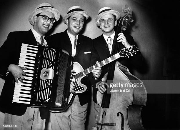 Three musicians from a band with guitar contrabass and accordion Photographer Charlotte Willott Published by 'Radio Revue' 25/1960Vintage property of...