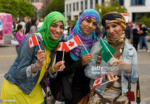 Three Muslim woman wave their flags during the Canada Day celebration on July 1 2009 in Vancouver British Columbia Canada This year's Canada Day...