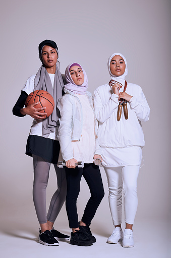 Three Muslim women in fitness wear looking at camera - gettyimageskorea