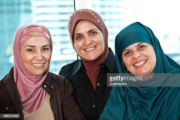 three muslim women - arab women fat stock pictures, royalty-free photos & images