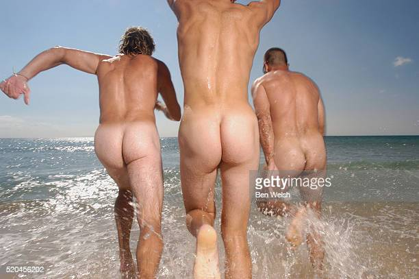 Three Naked Men Running into the Sea
