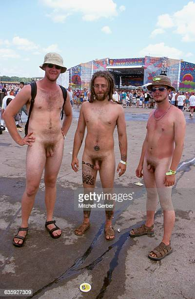 Three naked young men at Woodstock '99 A stage is in the background