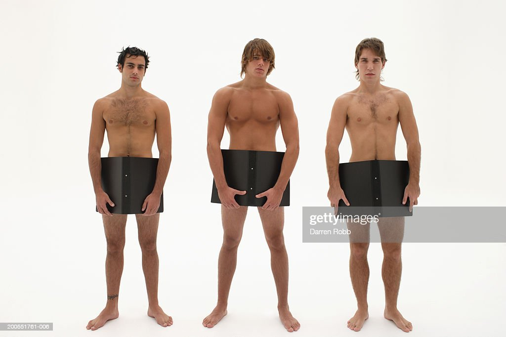 Three Naked Young Men Covering Groin With Black Office Folders Portrait Stock Photo