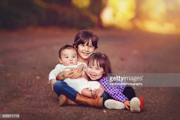 three native american children sitting on a path - 2 5 mesi foto e immagini stock