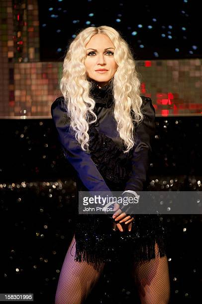 Three new Madonna wax figures go on display at Madame Tussauds on December 13 2012 in London England