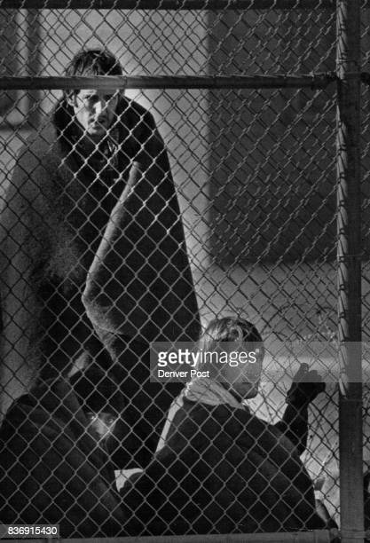 Three new Mexico State Penitentiary Inmates Huddle Along side the Fence Monday They were being kept in the prison yard protected by blankets until...