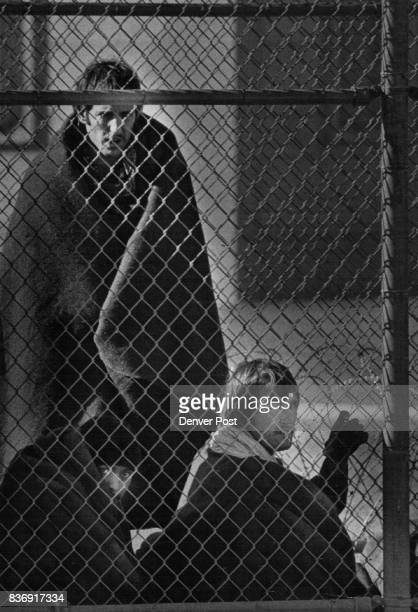 Three New Mexico State Penitentiary Inmates Huddle Alongside the fence Monday They were being kept in the prison yard protected by blankets until...