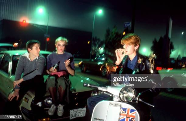 Three new wave/punk rockers hang out and smoke on the corner of Argyle and Selma circa December, 1981 in Los Angeles, California.