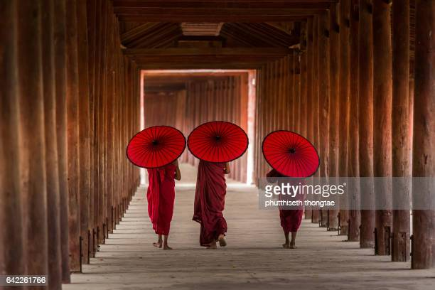 Three novice monks are walking in temple,Bagan,Myanmar