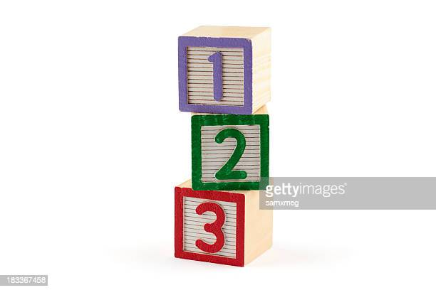 three numbered building blocks on white background - number 2 stock pictures, royalty-free photos & images