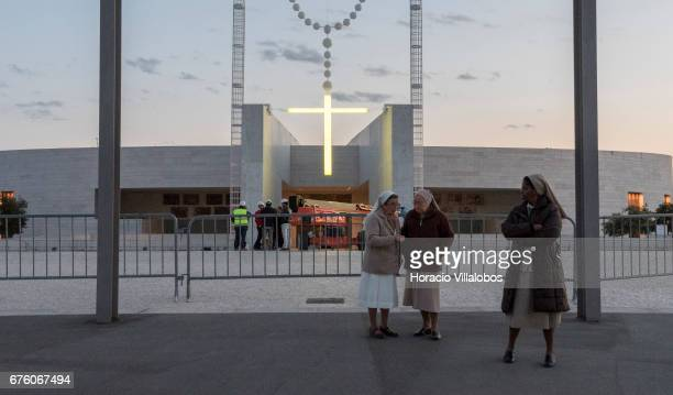 Three nuns are seen on the foreground while members of the staff of Portuguese artist Joana Vasconcelos conduct lights trials after having erected...