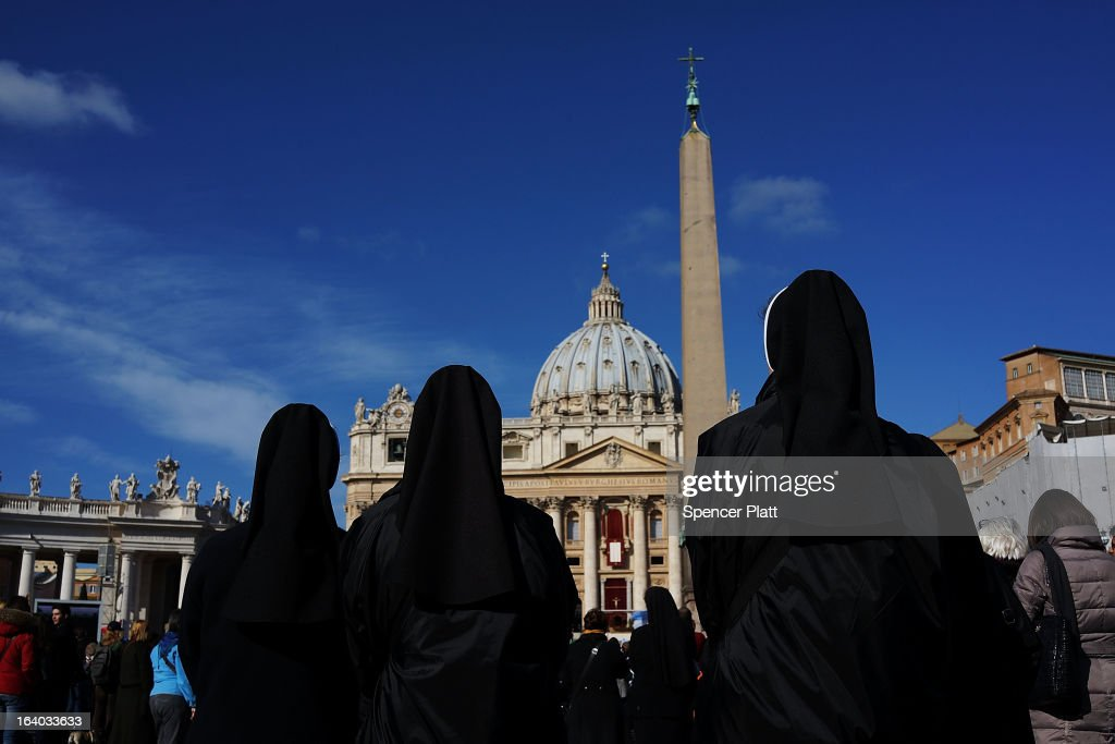 Three nuns listen to the Inauguration Mass for Pope Francis in St Peter's Square on March 19, 2013 in Vatican City, Vatican. The mass is being held in front of an expected crowd of up to one million pilgrims and faithful who have filled the square and the surrounding streets to see the former Cardinal of Buenos Aires officially take up his role as pontiff.