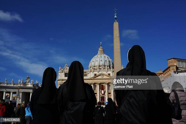 Three nuns listen to the Inauguration Mass for Pope Francis in St Peter's Square on March 19 2013 in Vatican City Vatican The mass is being held in...