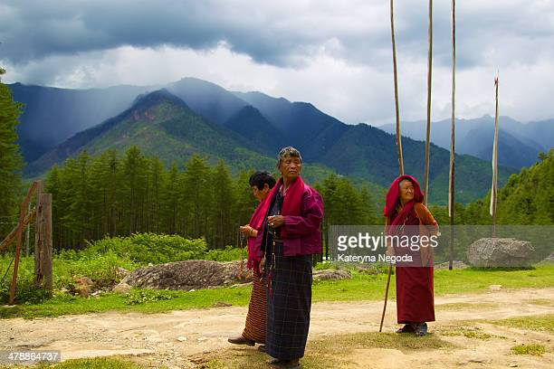 CONTENT] Three nuns Mountain landscape Dramatic sky Paro Bhutan