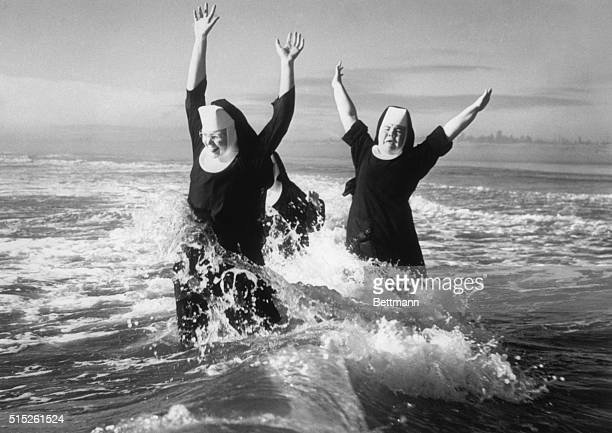 Three nuns play in the ocean surf near Grayland They were part of a group of seven nuns who were able to spend a week at the seashore as part of a...