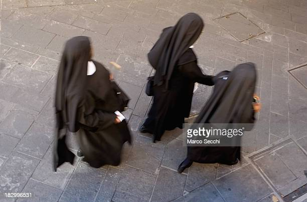 Three nuns walk along the streets of Assisi ahead of the visit of Pope Francis on October 3 2013 in Assisi Italy Pope Francis is due to venerate the...