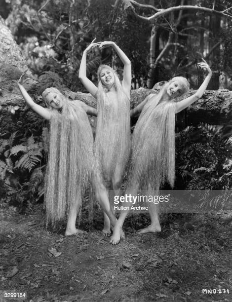 Three nymphets dance in a glade in a scene from 'A Midsummer Night's Dream' directed by Max Reinhardt and William Dieterle for Warner Brothers