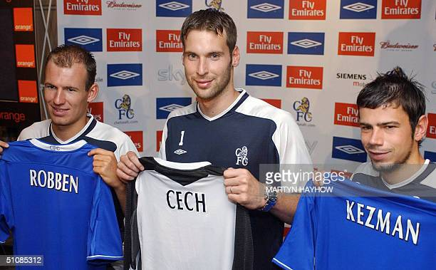Three of Chelsea football club's new signings Dutch winger Arjen Robben Czech goalkeeper Petr Cech and Serbian striker Mateja Kezman pose with their...