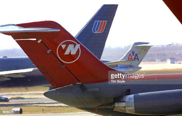 Three of four possible striking airlines'' jet tails are visible as they taxi February 20 2001 at Chicago's O''Hare International Airport Possible...