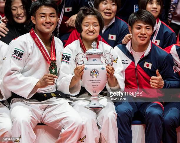 Three of Japan's gold medal winners Soichi Hashimoto Funa Tonaki and Hifumi Abe proudly sit holding the beautiful Suzuki vase during the 2017 Suzuki...