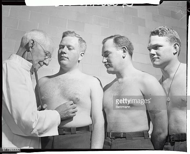 Three of the 21 student pilots that began classes at the American Airlines School at North Beach Airport are shown taking their physical examination...