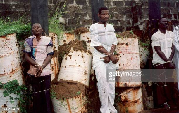 Three of the 43 prisoners who were sentenced to death are seen before their mass execution by firingsquad before a crowd of 1000 spectators 22 July...