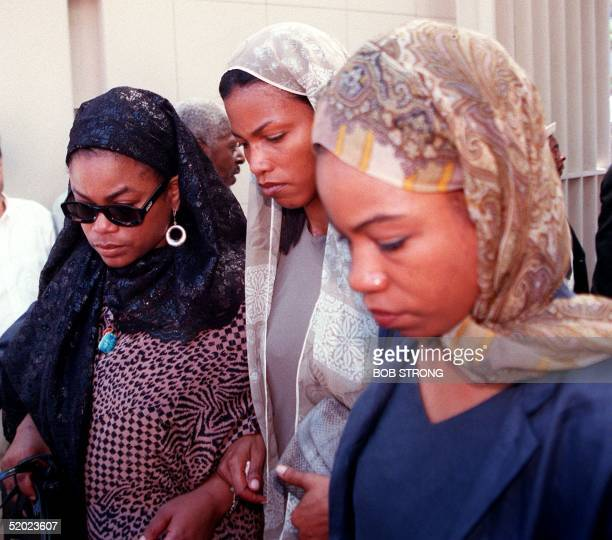Three of the daughters of Betty Shabazz enter the Islamic Cultural Center in New York for private funeral services 27 June 1997 Shabazz the widow of...