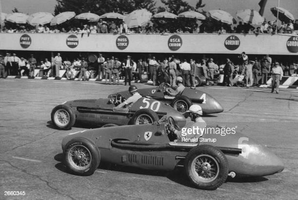Three of the favourites for the Monza Grand Prix lining up for the start They are No 4 Alberto Ascari in a Ferrari No 50 Juan Manuel Fangio in a...