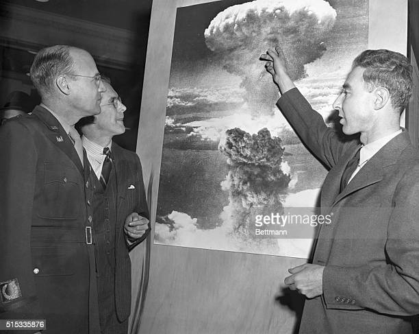 Three of the men who played leading roles in the development of the atomic bomb visit the American Chemical Society Atomic Exhibit in Grand Central...