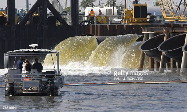 Three of the new exhaust pipes at the US Army Corps of Engineers 17th Street Outfall Canal in New Orleans 27 August 2007 blast water out of the lower...