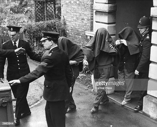 Three of the suspects arrested in connection with the 'Great Train Robbery' photographed leaving Linslade court with blankets over their heads