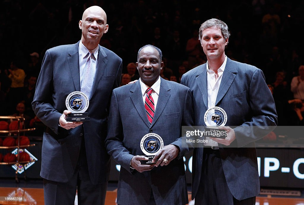 Three of the Top 75 All-Time NCAA March Madness players (L-R) Kareem Abdul-Jabbar, David Thompson and Christian Laettner are honored on the court during halftime of the NIT Season Tip-Off Championship Game at Madison Square Garden on November 23, 2012 in New York City.