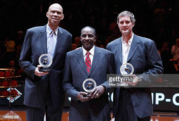 Three of the Top 75 AllTime NCAA March Madness players Kareem AbdulJabbar David Thompson and Christian Laettner are honored on the court during...