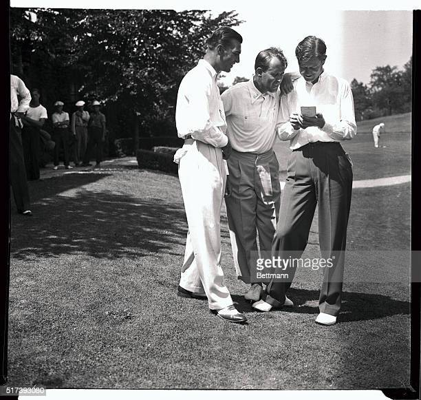 Three of the top-rank professional golfers in the country are shown here comparing cards after a practice round at the Oakwood Golf Course in...