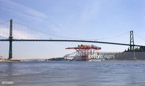 Three of the world's largest Super PostPanamax Cranes pass under the Lions Gate bridge April 27 2005 in Vancouver Canada The cranes arrived at the...
