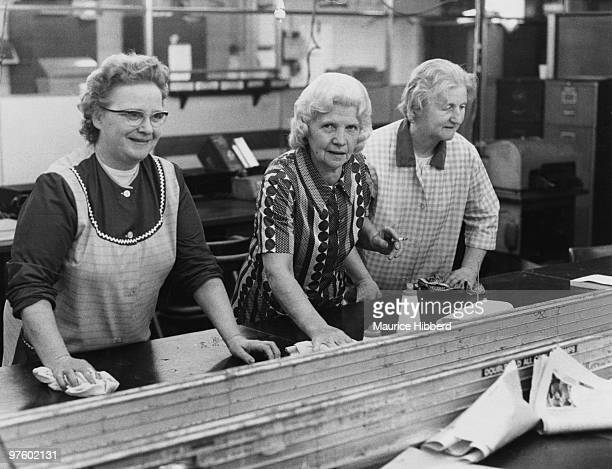 Three office cleaners at work after hours October 1973 They are Mrs Mabel Warren Mrs Betty Stone and Mrs Flo Ring