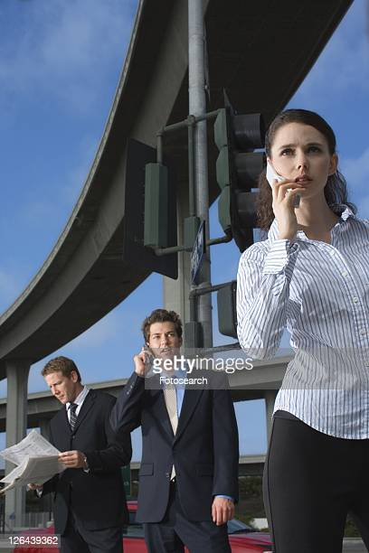 Three Office Workers by the Elevated Road, Low Angle View, Three Quarter Length, Front View